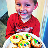boy holding cupcakes