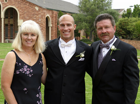 Eric with his mom and dad at wedding