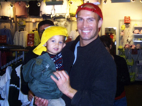 Eric and child with hats on