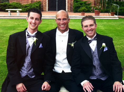 Eric and his two brothers at wedding