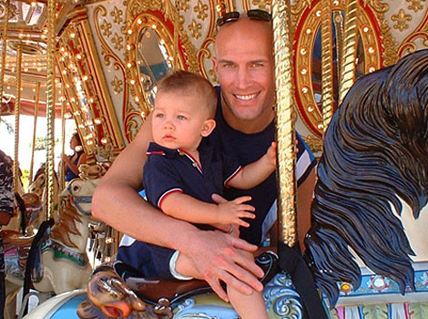 Eric and child on marry-go-round