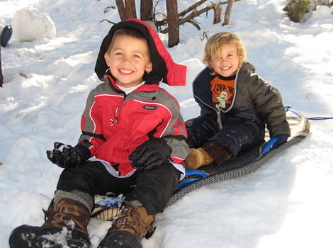 our children sledding in the snow