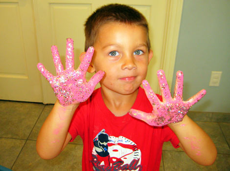child showing off colored hands
