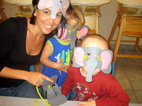 the kids and Jamie showing off their elephant hats