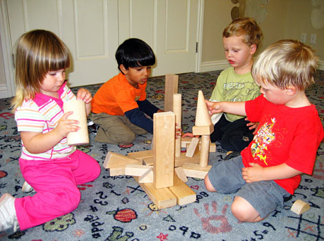 children building castles with large blocks